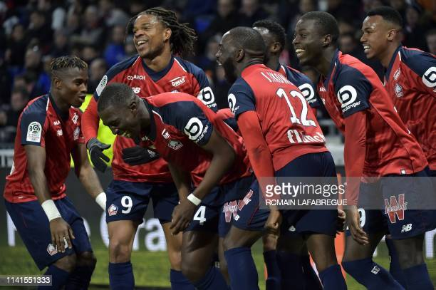 Lille's French midfielder Boubakary Soumare celebrates with Lille's French forward Loic Remy and teammates after scoring a goal during the French L1...