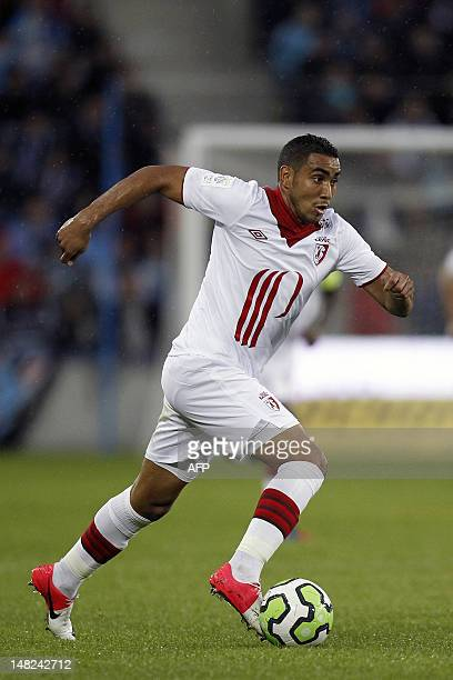 Lille's French midfielder Dimitri Payet runs with the ball during the friendly football match Le Havre vs Lille on July 12 at the newly inaugurated...