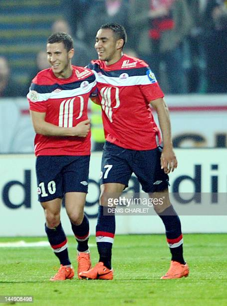 Lille's French midfielder Eden Hazard is congratuled by his teammate Lille's French forward Dimitri Payet during the French L1 football match Lille...