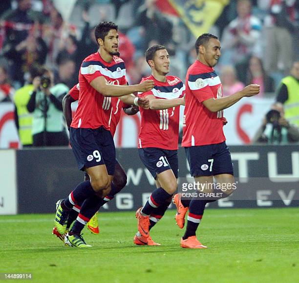 Lille's French midfielder Eden Hazard Lille's Brazilian forward Tulio De Melo and Lille's French forward Dimitri Payet celebrate after a goal during...