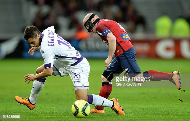 Lille's French midfielder Florent Balmont challenges Toulouse's French forward Wissam Ben Yedder during the French L1 football match between Lille...
