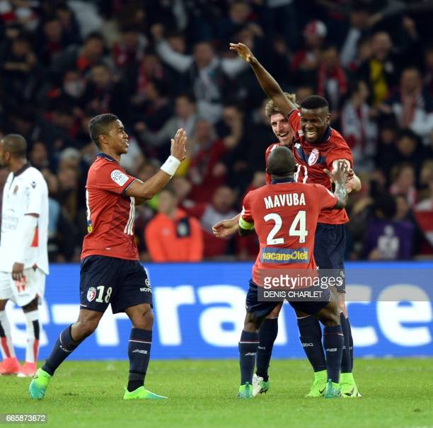Lille's French midfielder Ibrahim Amadou celebrates with teammates after scoring a goal during the French L1 football match between Lille and Nice at...