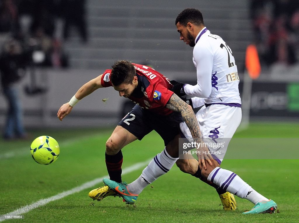 Lille's French midfielder Mathieu Debuchy (L) vies with Toulouse's French midfielder Etienne Capoue during the French L1 football match LOSC Lille vs Toulouse FC, on December 11, 2012 at the Lille Grand Stade stadium in Villeneuve d'Ascq.