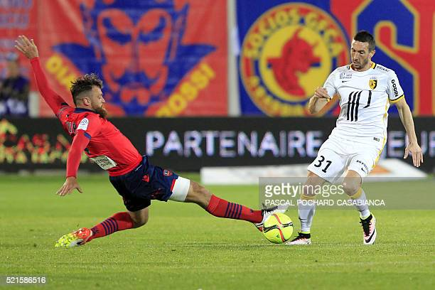 Lille's French midfielder Morgan Amalfitano vies with Ajaccio's French defender Roderic Filippi during the French L1 football match Gazelec Ajaccio...