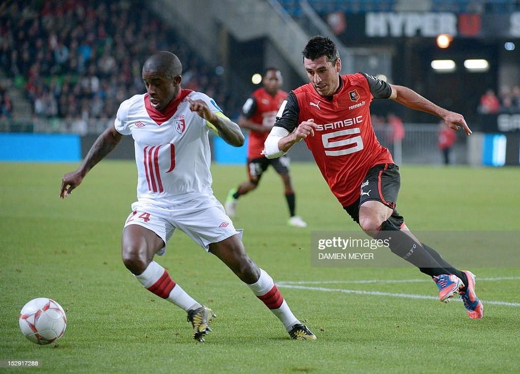 Lille's French midfielder Rio Mavuba (L) fights for the ball with Rennes' French midfielder Julien Feret during the French L1 football match Stade Rennais FC vs Lille LOSC, on September 28, 2012, at the route de Lorient stadium in Rennes, western France.