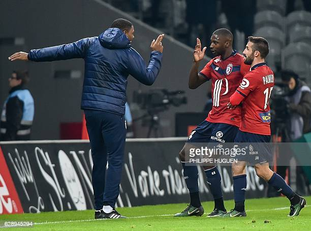Lille's French midfielder Younousse Sankhare celebrates after scoring a goal during the French L1 football match Lille vs Montpellier on December 10...