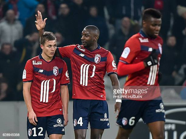Lille's French midfielder Younousse Sankhare celebrates with teammates after scoring a goal during the French L1 football match Lille vs Montpellier...