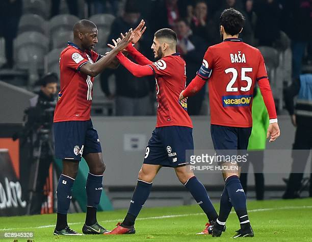Lille's French midfielder Younousse Sankhare is congratulated by teammates after scoring a goal during the French L1 football match Lille vs...