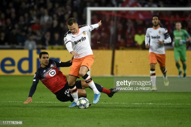 Lille's French midfileder Benjamin Andre and Valencia's Russian midfielder Denis Cheryshev vie for the ball during the UEFA Champions League Group H...
