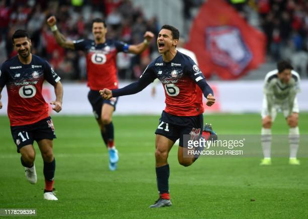 Lille's French midfileder Benjamin Andre reacts after scoring a goal during the French L1 football match between Lille LOSC and FC Girondins de...