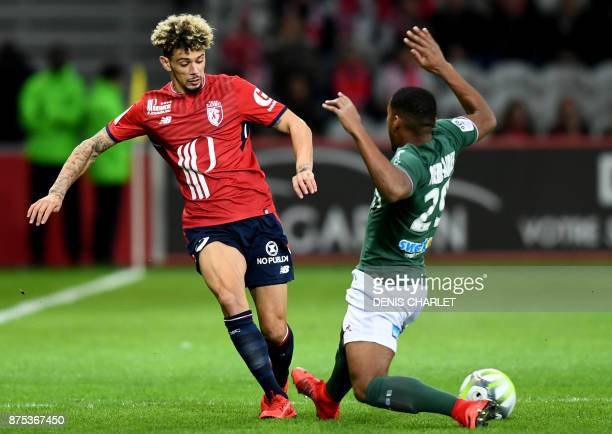 Lille's French Moroccan defender Kevin Malcuit vies with SaintEtienne's French defender Ronael PierreGabriel during the French L1 football match...
