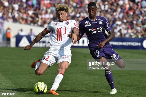Lille's French Moroccan defender Kevin Malcuit vies with Toulouse's Brazilian midfielder Somalia during the French L1 football match Toulouse against...