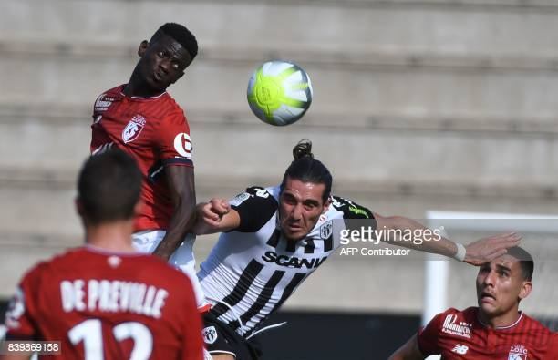 Lille's FrenchMalian defender Adama Soumaoro fights for the ball with Angers' French forward Enzo Crivelli during the French L1 football match...