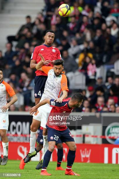Lille's Gabriel Dos Santos Magalhaes heads the ball above Facundo Piriz Gonzalez during the Ligue 1 match between Lille and Montpellier at Stade...
