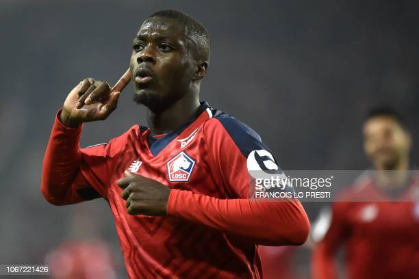 Lille's Ivorian forward Nicolas Pepe celebrates after scoring a goal during the French L1 football match between Lille and Olympique Lyonnais on...