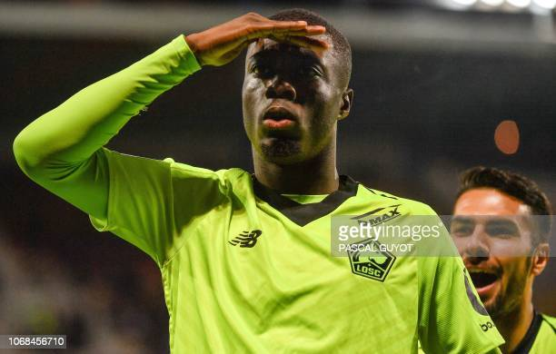 Lille's Ivorian forward Nicolas Pepe celebrates after scoring a goal during the French L1 football match between Montpellier and Lille on December 4...