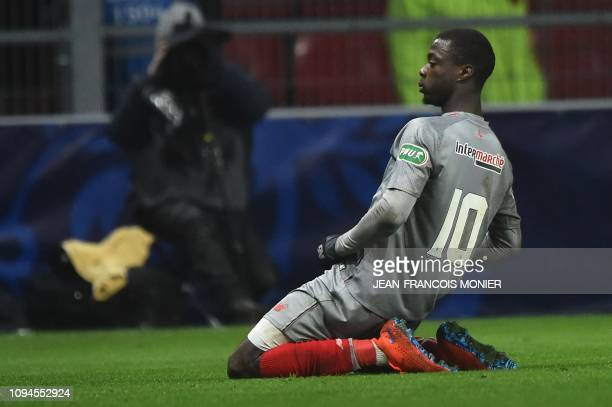 Lille's Ivorian forward Nicolas Pepe celebrates after scoring a goal during the French Cup round of 16 football match between Rennes and Lille on...