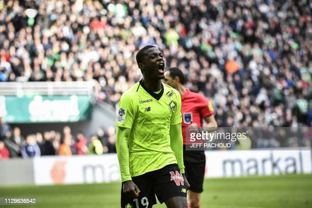 Lille's Ivorian forward Nicolas Pepe celebrates after scoring a goal during the L1 football match AS SaintEtienne vs Lille on March 10 at the...