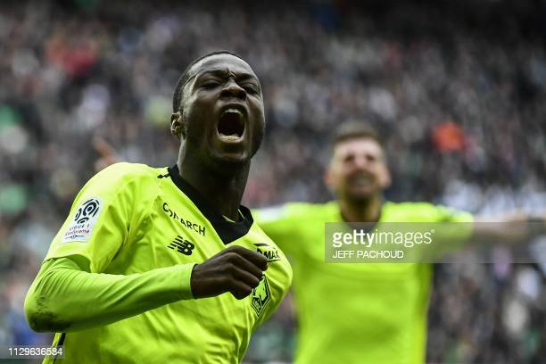 Lille's Ivorian forward Nicolas Pepe celebrates after scoring a goal during the L1 football match AS Saint-Etienne vs Lille on March 10 at the...