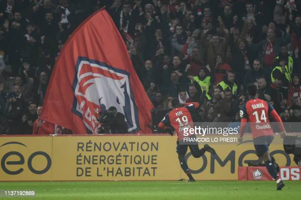 Lille's Ivorian forward Nicolas Pepe celebrates after scoring a goal during the French L1 football match between Lille and Paris SaintGermain on...
