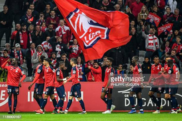 Lille's Ivorian forward Nicolas Pepe celebrates after scoring a goal during the French L1 football match between Lille and Nimes Olympique at the...