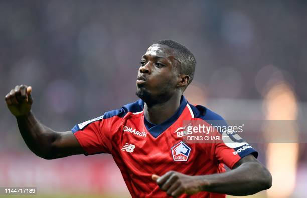 Lille's Ivorian forward Nicolas Pepe celebrates after scoring a goal during the French L1 football match between Lille and Angers at the...