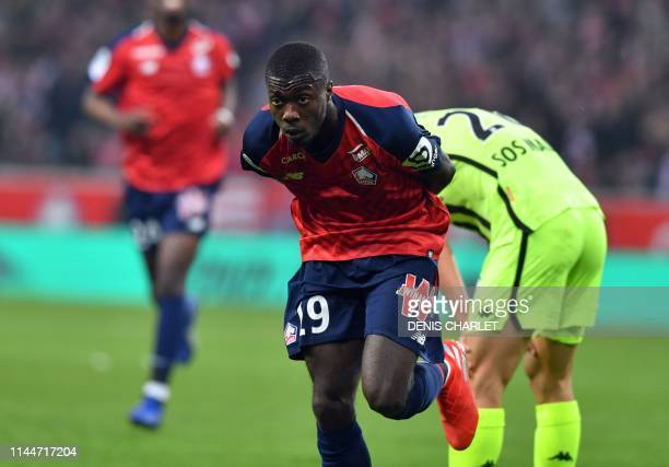 Lille's Ivorian forward Nicolas Pepe celebrates after scoring a goal during the French L1 football match between Lille and Angers at the PierreMauroy...
