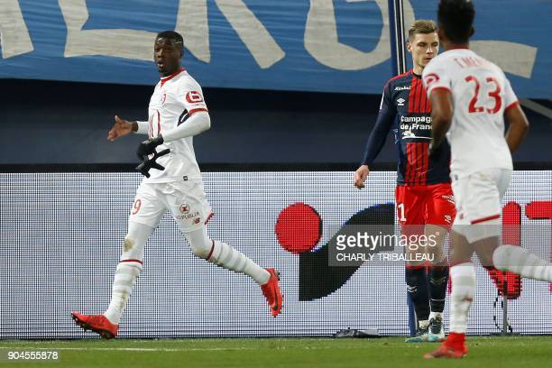 Lille's Ivorian forward Nicolas Pepe celebrates after scoring a goal during the French L1 football match between Caen and Lille on December 13 at the...