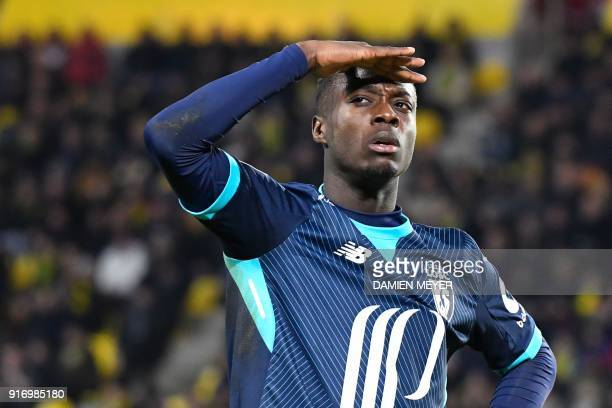 Lille's Ivorian forward Nicolas Pepe celebrates after scoring during the French L1 football match Nantes against Lille on February 11 2018 at the La...