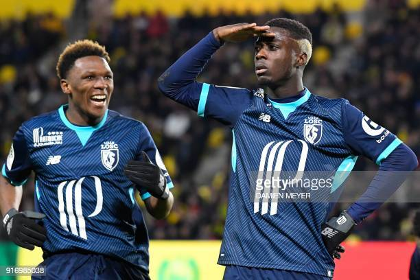Lille's Ivorian forward Nicolas Pepe celebrates with Lille's South Africa striker Lebo Mothiba after scoring during the French L1 football match...