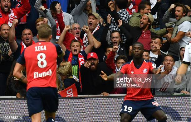 Lille's Ivorian forward Nicolas Pepe celebrates with teammate Portuguese midfielder Xeka after scoring a goal during the French L1 football match...