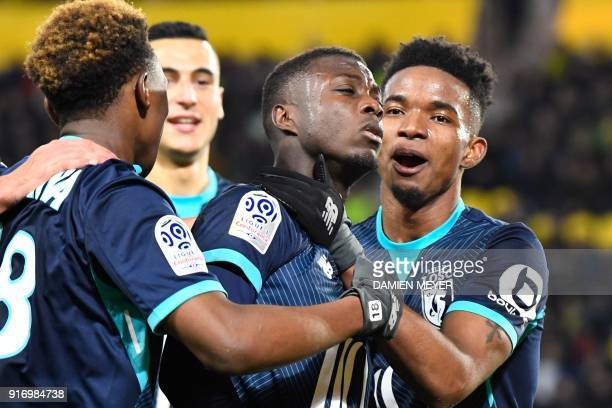 Lille's Ivorian forward Nicolas Pepe celebrates with teammates after scoring during the French L1 football match Nantes against Lille on February 11...