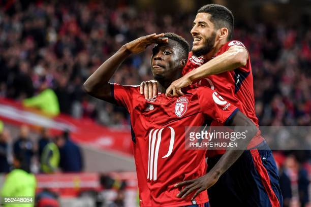 Lille's Ivorian forward Nicolas Pepe celebrates with teammates during the French L1 football match between Lille and Metz on April 28 2018 at the...