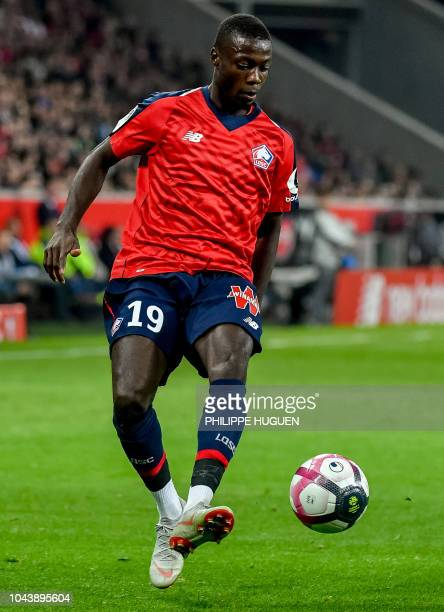 Lille's Ivorian forward Nicolas Pepe controls the ball during the French L1 football match Lille vs Olympique de Marseille on September 30 2018 at...