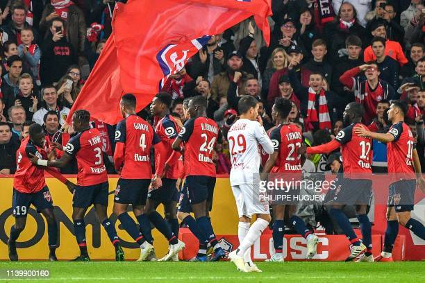 Lille's Ivorian forward Nicolas Pepe is congeratulates by teammates after scoring a goal during the French L1 football match between Lille and Nimes...