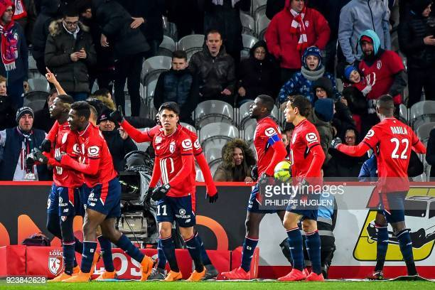 Lille's Ivorian forward Nicolas Pepe is congratulated by his teammates after scoring a goal during the French L1 football match Lille vs Angers on...