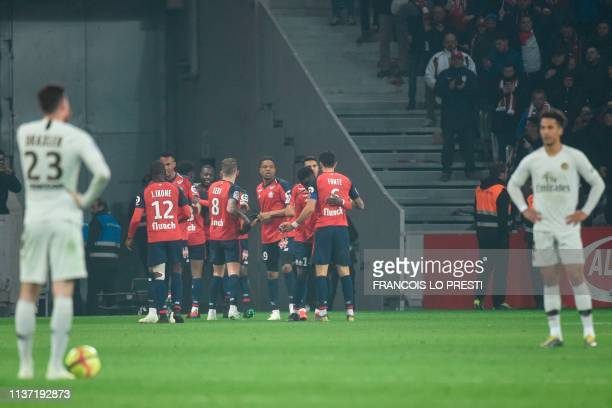 Lille's Ivorian forward Nicolas Pepe is congratulated by teammates after scoring a goal during the French L1 football match between Lille and Paris...