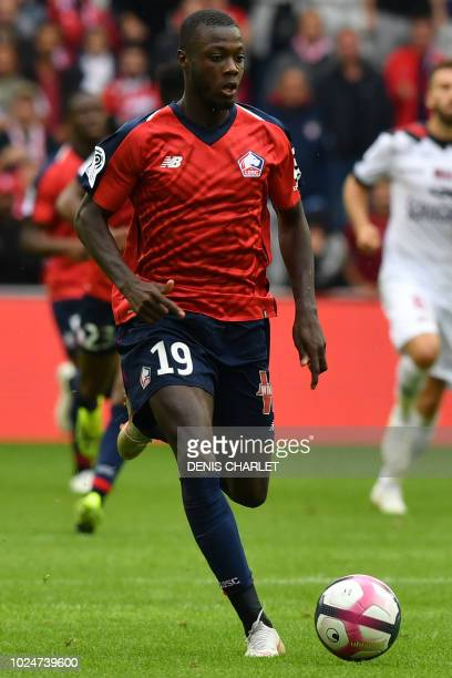 Lille's Ivorian forward Nicolas Pepe runs with the ball during the French L1 football match between Lille OSC and Guingamp at the PierreMauroy...