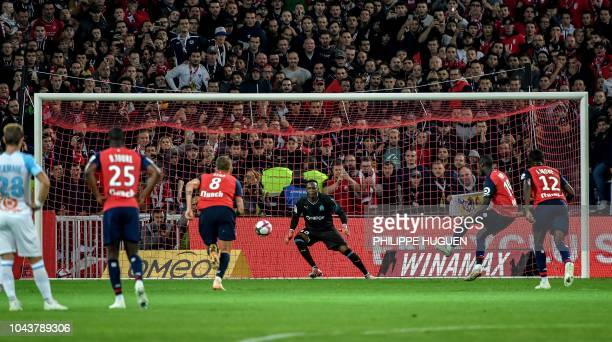 Lille's Ivorian forward Nicolas Pepe scores during the French L1 football match between Lille and Marseille on September 30 2018 at the Pierre Mauroy...