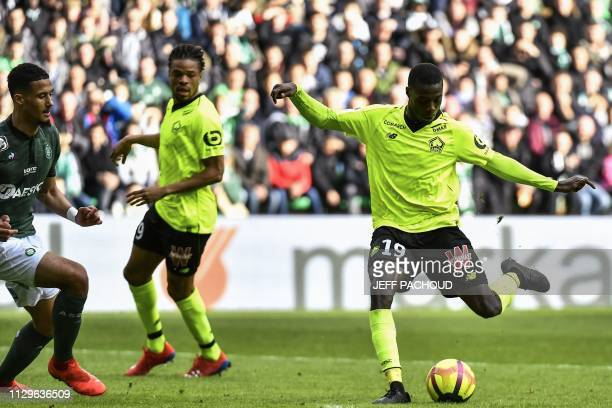 Lille's Ivorian forward Nicolas Pepe shoots and scores a goal during the L1 football match AS SaintEtienne vs Lille on March 10 at the Geoffroy...