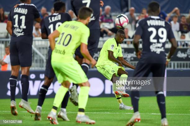 Lille's Ivorian forward Nicolas Pepe shoots the ball during the French L1 football match between Bordeaux and Lille on September 26 2018 at the...