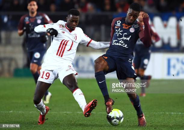 Lille's Ivorian forward Nicolas Pepe vies with Montpellier's French forward Isaac Mbenza during the French L1 football match between Montpellier and...