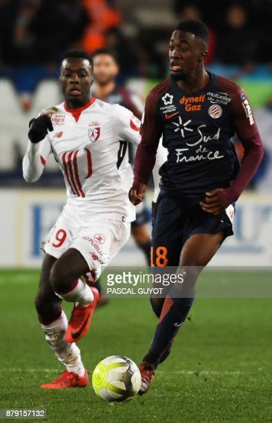Lille's Ivorian forward Nicolas Pepe vies with Montpellier's French forward Isaac Mbenza during the French L1 football match between MHSC Montpellier...