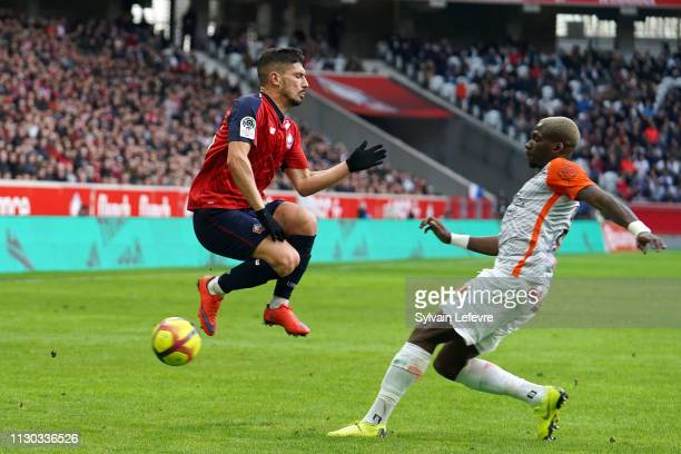 Lille's Jeremy Pied in action with Montpellier's Ambroise Oyongo Bitolo during the Ligue 1 match between Lille and Montpellier at Stade Pierre Mauroy...