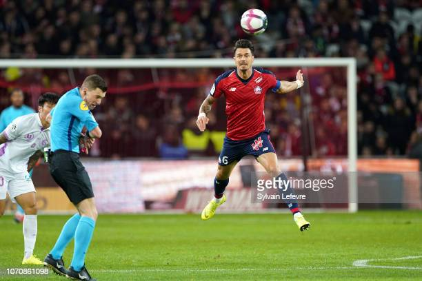 Lille's Jose Miguel Da Rocha Fonte heads the ball in front of principal referee Willy Delajod during Ligue 1 match between Lille OSC and Stade de...