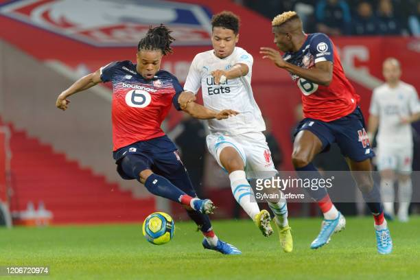 Lille's Loic Remy , Victor Osimhen and Marseille's Boubacar Kamara during the Ligue 1 match between Lille OSC and Olympique Marseille at Stade Pierre...