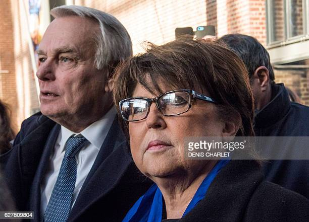 Lille's Mayor Martine Aubry flanked by French Foreign minister JeanMarc Ayrault talks to journalists on December 5 2016 during a visit to the...