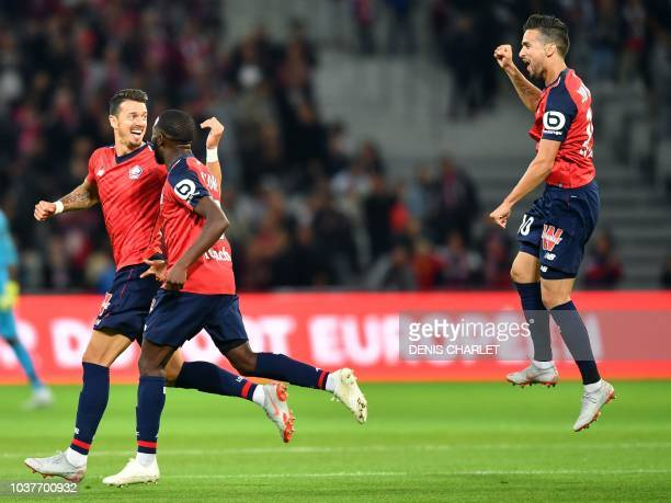 Lille's midefielder Jose Da Rocha Fonte celebrates past teammates after scoring during the French L1 football match between Lille OSC and Nantes at...