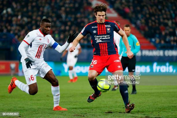 Lille's midfielder Ibrahim Amadou vies for the ball with Caen's Croatian forward Ivan Santini during the French L1 football match between Caen and...