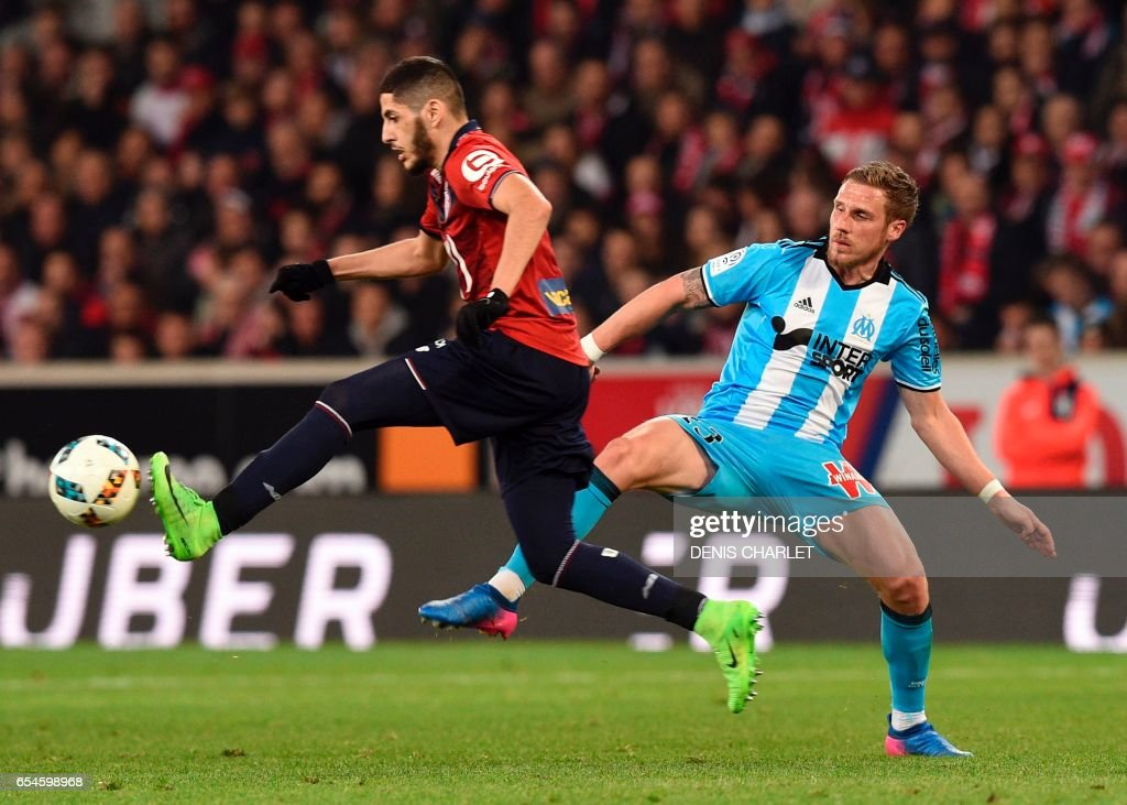 Lille's midfielder Xeka (L) vies with Olympique de Marseille's French defender Gregory Sertic during the French L1 football match between Lille OSC (LOSC) and Marseille on March 17, 2017 at the Pierre-Mauroy Stadium in Villeneuve d'Ascq, near Lille, northern France. /